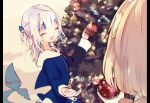 2girls :d ^_^ bangs blonde_hair blue_hair blue_hoodie blunt_bangs christmas christmas_lights christmas_ornaments christmas_tree close-up closed_eyes commentary drawstring fish_tail gawr_gura grey_nails hair_ornament holding hololive hololive_english hood hood_down hoodie long_sleeves monocle_hair_ornament multicolored_hair multiple_girls nail_polish open_mouth pillarboxed pine_tree saya_(sayaya) shark_girl shark_tail sharp_teeth silver_hair sleeves_past_wrists smile streaked_hair symbol_commentary tail teeth tree two_side_up virtual_youtuber watson_amelia white_hair