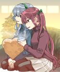 2girls alternate_costume asagumo_(kantai_collection) beige_skirt black_legwear black_sweater braid brown_eyes brown_hair christmas_dress commentary_request cup green_hairband green_sweater grey_eyes hair_ribbon hairband heart heart_pillow kantai_collection long_hair mug multiple_girls pantyhose pillow pleated_skirt ribbon sagamiso sidelocks silver_hair single_braid sitting skirt smile sweater turtleneck twintails wariza wavy_hair yamagumo_(kantai_collection)