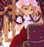 1girl absurdres arm_rest bangs blonde_hair chair closed_mouth collared_shirt cowboy_shot crossed_bangs crystal dress eyebrows_visible_through_hair finger_to_own_chin flandre_scarlet gloves hair_between_eyes hat highres kneeling light_smile looking_at_viewer mob_cap pointy_ears puffy_short_sleeves puffy_sleeves red_dress red_eyes shi_chimi shirt short_hair short_sleeves solo touhou white_gloves white_headwear white_shirt wings