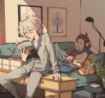 2boys ahoge alternate_costume blue_pants book brown_eyes brown_hair closed_eyes couch danganronpa_(series) danganronpa_2:_goodbye_despair drooling feet_out_of_frame highres hinata_hajime holding holding_book holding_magazine indoors komaeda_nagito lamp long_sleeves lying magazine male_focus medium_hair messy_hair multiple_boys on_back on_couch open_mouth painting_(object) pajamas pants pillow ponytail revo_toumeijin shirt short_hair sitting striped striped_pajamas striped_pants striped_shirt table two-tone_shirt