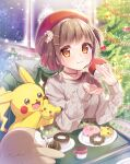 1girl :t blush brown_eyes brown_hair christmas christmas_tree closed_mouth commentary_request cup doughnut earrings eating eyelashes food gen_1_pokemon gen_7_pokemon hat highres indoors jewelry kisukekun long_sleeves looking_at_viewer necklace pikachu plate pokemon pokemon_(creature) red_headwear rowlet short_hair signature snowflakes sparkle sweater tam_o'_shanter