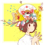 1girl akabeko arrow_(projectile) bangs blush branch brown_eyes brown_hair daruma_doll dice fan fish flower hands_together hands_up highres leaf object_on_head original pink_flower rope shirt short_hair smile solo upper_body white_flower white_shirt yellow_background yoshimon