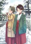 2girls ayanami_(kantai_collection) brown_eyes brown_hair coat drink hakama highres holding holding_drink japanese_clothes kantai_collection long_hair looking_at_viewer matsutani multiple_girls ponytail red_hakama shikinami_(kantai_collection) side_ponytail snow torii winter winter_clothes winter_coat