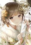 1girl al_mican bangs blush brown_eyes brown_hair closed_mouth commentary_request eyebrows_visible_through_hair fur_collar hair_ornament highres holding japanese_clothes kimono long_sleeves looking_at_viewer new_year original short_hair smile solo translation_request upper_body wide_sleeves yellow_kimono