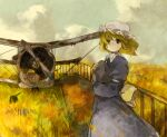 1girl aircraft airplane back_bow black_eyes blonde_hair blue_dress bow clouds commentary day dress field hat highres holding holding_rock kaigen_1025 long_sleeves looking_at_viewer maribel_hearn mob_cap outdoors rock short_hair solo touhou upper_body white_headwear wind