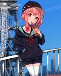 1girl absurdres badge baseball_cap black_headwear black_hoodie blurry blurry_background bubble_tea cio_hakatano cityscape commentary_request cowboy_shot cup drinking drinking_straw hair_tie handrail hat highres holding holding_cup hood hoodie kotonoha_akane leaning_back medium_hair pink_eyes pink_hair shorts thigh-highs tower voiceroid white_legwear