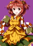 1girl apron bangs bell book checkered checkered_kimono clothes_writing cowboy_shot eyebrows_visible_through_hair green_skirt hair_bell hair_between_eyes hair_ornament highres holding holding_book japanese_clothes kimono long_sleeves looking_at_viewer medium_hair motoori_kosuzu open_mouth purple_background red_eyes redhead ruu_(tksymkw) simple_background skirt smile solo standing teeth touhou twintails wide_sleeves yellow_apron