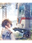 1girl brown_eyes brown_hair daito day from_behind ground_vehicle highres looking_back original outdoors short_hair solo sweater_vest train upper_body wind