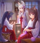 3girls :d animal_ear_fluff animal_ears bangs black_hair blue_eyes blush brown_hair cat_ears clock closed_eyes closed_mouth commentary_request eyebrows_visible_through_hair flower folded_ponytail fox_ears fox_girl fox_tail hair_between_eyes hair_flower hair_ornament hakama heater highres holding indoors iroha_(iroha_matsurika) japanese_clothes kimono knitting knitting_needle long_hair long_sleeves miko multiple_girls needle open_mouth original ponytail profile purple_flower red_hakama silver_hair sitting smile snowing standing tail very_long_hair violet_eyes wall_clock white_kimono wide_sleeves window wooden_floor yarn yarn_ball