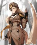 1girl black_legwear blonde_hair blue_eyes breasts brown_capelet brown_coat buttons coat curvy fingerless_gloves forest fur_hat gloves guilty_gear guilty_gear_strive hat highres incoming_attack kamrinwebby long_hair looking_at_viewer medium_breasts millia_rage nature pantyhose prehensile_hair solo standing ushanka very_long_hair wide_hips winter_clothes winter_coat