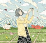 1girl awai880 black_skirt blue_sky cardigan clouds cloudy_sky cowboy_shot flag grass grey_eyes grey_hair grey_shirt hands_up jewelry maneki-neko mountain octopus original outdoors print_shirt ring shirt short_hair signature skirt sky socks solo yellow_cardigan
