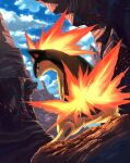 closed_mouth clouds commentary_request day fire from_below gen_2_pokemon highres karamimame looking_back no_humans outdoors pokemon pokemon_(creature) quilava sky solo standing