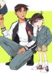 2boys bangs baseball_cap black-framed_eyewear black_footwear blue_eyes blue_jacket brown_hair brown_shorts buttons casual cellphone child commentary_request dark_skin dark_skinned_male denim denim_jacket edogawa_conan glasses green_background grey_pants hand_in_pocket hat hattori_heiji headwear_removed highres holding holding_clothes holding_hat holding_phone jacket k_(gear_labo) letterman_jacket long_sleeves looking_at_another male_focus meitantei_conan multiple_boys one_knee open_clothes open_jacket open_mouth pants phone serious shirt shoes short_hair shorts sneakers socks standing two-tone_background v-shaped_eyebrows white_background white_legwear white_shirt