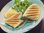 bowl chips commentary food food_focus highres kara-age_daisuki leaf meat no_humans original panini_(food) sandwich simple_background still_life tomato tomato_slice vegetable
