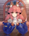 1girl absurdres alternate_hairstyle animal_ear_fluff animal_ears artist_name artist_request chaldea_logo character_name closed_mouth coffee eyebrows_visible_through_hair fang fate/extra fate/grand_order fate_(series) fox_ears fox_girl fox_tail highres indoors looking_at_viewer off-shoulder_sweater off_shoulder pink_hair skin_fang solo sweater tail tamamo_(fate)_(all) tamamo_no_mae_(fate) twintails yellow_eyes