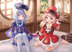 2girls :d absurdres ahoge bangs beads blonde_hair blue_dress blue_hair blush braid braided_ponytail brown_gloves character_request chestnut_mouth dress eyebrows_visible_through_hair fang feet_out_of_frame flat_chest genshin_impact gloves hair_ornament hat highres ichizon indoors jiangshi klee_(genshin_impact) light_rays long_hair looking_at_viewer multiple_girls ofuda on_bed open_mouth pillow pink_eyes qing_guanmao qiqi red_dress red_eyes red_headwear round_window sitting smile swept_bangs tassel thigh-highs very_long_hair wariza waving white_legwear