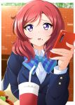 1girl :o arm_rest bangs black_jacket blue_neckwear blush bow bowtie breasts brick_wall cellphone collar collared_shirt cup disposable_cup drinking_straw food food_on_face hair_between_eyes hamburger highres holding holding_phone jacket kirisaki_reina long_sleeves looking_at_viewer love_live! love_live!_school_idol_project medium_breasts medium_hair nishikino_maki open_mouth outdoors phone redhead school_uniform shirt smartphone solo uniform upper_body upper_teeth violet_eyes white_collar white_shirt