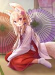 1girl animal_ear_fluff animal_ears bangs blonde_hair blush commentary_request eyebrows_visible_through_hair flower folded_ponytail fox_ears fox_girl fox_tail full_body hair_between_eyes hair_flower hair_ornament hakama highres iroha_(iroha_matsurika) japanese_clothes kimono long_hair long_sleeves looking_at_viewer miko no_shoes oil-paper_umbrella on_floor open_mouth original pink_flower purple_umbrella red_hakama red_umbrella sitting sleeves_past_fingers sleeves_past_wrists socks solo tabi tail tatami umbrella very_long_hair violet_eyes wariza white_kimono white_legwear