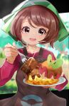 1girl applin apron bangs blush bob_cut brown_apron brown_eyes brown_hair chocolate collarbone commentary_request eyebrows_visible_through_hair eyelashes fingernails fork gen_8_pokemon gloria_(pokemon) green_headwear hand_up head_tilt highres holding holding_fork incoming_food long_sleeves looking_at_viewer open_mouth outline pokemon pokemon_(game) pokemon_swsh short_hair smile teeth tongue umiru