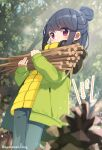 1girl :o ayataka bangs black_hair blue_pants blurry blurry_foreground blush carrying commentary_request day depth_of_field eyebrows_visible_through_hair green_jacket hair_bun highres jacket long_sleeves open_clothes open_jacket outdoors pants parted_lips pinecone red_eyes shima_rin sleeves_past_wrists solo standing stick translation_request tree twitter_username yellow_jacket yurucamp