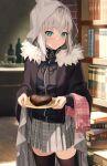 1girl ahoge apron aqua_eyes bangs black_legwear blush book bookshelf cake chocolate chocolate_cake cloak cowboy_shot eyebrows_visible_through_hair fate_(series) food fork fur_trim gray_(fate) grey_cloak heart-shaped_cake highres holding holding_plate hood hoodie indoors long_sleeves looking_at_viewer lord_el-melloi_ii_case_files mocha_(mokaapolka) parted_lips pink_apron plate pleated_skirt short_hair silver_hair sink skirt solo thigh-highs