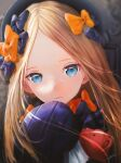 1girl abigail_williams_(fate) bangs black_bow black_dress black_headwear blonde_hair blue_eyes bow breasts dress fate/grand_order fate_(series) forehead hair_bow hat highres long_hair multiple_bows ojay_tkym orange_bow parted_bangs polka_dot polka_dot_bow ribbed_dress sleeves_past_fingers sleeves_past_wrists small_breasts stuffed_animal stuffed_toy teddy_bear