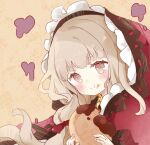1girl :t bangs blush brown_background brown_eyes brown_hair capelet closed_mouth commentary_request eating eyebrows_visible_through_hair food food_on_face holding holding_food hood hood_up hooded_capelet little_red_riding_hood_(sinoalice) long_hair red_capelet short_eyebrows sinoalice solo thick_eyebrows tsukiyo_(skymint) upper_body