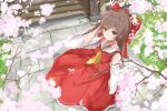 1girl absurdres ascot bangs blush bow brown_hair cherry_blossoms closed_mouth day detached_sleeves eyebrows_visible_through_hair flower frills grass hair_bow hair_tubes hakurei_reimu hand_in_hair hand_up highres long_hair looking_at_viewer na_kyo outdoors petals red_bow shrine skirt solo spring_(season) standing touhou tree tree_branch very_long_hair wide_sleeves yellow_eyes yellow_neckwear