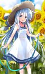 1girl bangs blue_eyes blurry blurry_background blush brown_headwear clouds commentary_request day dress eyebrows_visible_through_hair flower hat hibiki_(kancolle) highres hizuki_yayoi holding holding_hose hose kantai_collection long_hair open_mouth outdoors rainbow silver_hair sky solo sun_hat sunflower water white_dress yellow_flower