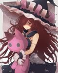 1girl anna_(granblue_fantasy) armband bare_shoulders big_hair black_gloves brown_eyes candle closed_mouth commentary_request dress frilled_hat frills gloves granblue_fantasy hair_over_one_eye hat highres holding holding_stuffed_toy long_hair messy_hair redhead solo stuffed_animal stuffed_cat stuffed_toy very_long_hair witch witch_hat yonaga