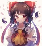 1girl alternate_hairstyle ascot bangs bare_shoulders blunt_bangs blurry bow breasts brown_hair closed_mouth depth_of_field detached_sleeves eyebrows_visible_through_hair falling_petals frilled_hair_tubes frilled_shirt_collar frills hair_bow hair_tubes hakurei_reimu highres light_smile long_hair looking_at_viewer medium_breasts moshihimechan orb petals red_bow red_eyes red_vest ribbon-trimmed_sleeves ribbon_trim short_hair short_hair_with_long_locks sidelocks simple_background solo touhou upper_body vest wavy_hair white_background yellow_neckwear yin_yang yin_yang_orb