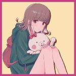 1girl animal_bag backpack bag bangs bare_legs beige_background blunt_bangs blush blush_stickers border bow brown_hair cat_bag closed_mouth danganronpa_(series) danganronpa_2:_goodbye_despair ear_bow eyebrows_visible_through_hair feet_out_of_frame flipped_hair frown green_jacket hair_ornament hairclip hand_up hands_on_own_knees highres hood hood_down hooded_jacket jacket jecheubo knees_up long_sleeves looking_at_viewer medium_hair nanami_chiaki pink_bag pink_border pink_bow pink_eyes protected_link shirt sitting skirt usami_(danganronpa)