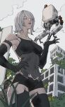 1girl act_(a_moso) android armlet bangs bare_shoulders black_gloves black_legwear black_shorts building closed_eyes clouds elbow_gloves from_below gloves hair_over_one_eye hand_on_hip highres joints mole mole_under_mouth nier_(series) nier_automata outdoors overgrown parted_lips plant pod_(nier_automata) post-apocalypse robot_joints rubble ruins short_hair shorts sky tank_top thigh-highs yorha_type_a_no._2