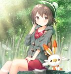 1girl backpack bag bangs blush bob_cut brown_bag brown_eyes brown_hair buttons cardigan closed_mouth collared_dress commentary_request day eyebrows_visible_through_hair from_below gen_8_pokemon gloria_(pokemon) green_headwear grey_cardigan hand_on_own_thigh hand_up hat hooded_cardigan kamowasa light_beam looking_at_viewer outdoors pokemon pokemon_(creature) pokemon_(game) pokemon_swsh scorbunny short_hair sitting starter_pokemon tam_o'_shanter tree
