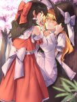 2girls against_tree apron arms_up black_hair black_skirt black_vest blonde_hair blurry blurry_background blurry_foreground blush bow cherry_blossoms cheunes clenched_hands commentary day detached_sleeves eye_contact eyebrows_visible_through_hair hair_between_eyes hair_bow hair_tubes hakurei_reimu hand_on_headwear hat hat_ribbon hat_tug highres kirisame_marisa long_hair looking_at_another multiple_girls nervous outdoors petticoat puffy_short_sleeves puffy_sleeves red_eyes red_skirt red_vest ribbon ribbon-trimmed_sleeves ribbon_trim sarashi shirt short_sleeves sidelocks skirt smile standing touhou tree very_long_hair vest waist_apron white_shirt witch_hat yellow_eyes yuri