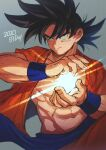 1boy 2020 abs belt black_eyes black_hair blue_belt blurry blurry_background closed_mouth collarbone cupping_hands depth_of_field dragon_ball dragon_ball_super dragon_ball_z energy_ball facing_viewer fingernails grey_background hands_up highres light light_particles light_rays looking_afar looking_to_the_side loose_belt male_focus mamefuku_(mamedehuku) muscular navel open_clothes open_shirt orange_shirt pectorals shaded_face shirt simple_background smile son_goku spiky_hair upper_body wristband