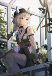 1girl absurdres animal_ears arknights beanstalk_(arknights) chromatic_aberration collared_shirt ears_through_headwear fedora feet_out_of_frame flower from_below gloves greenhouse hair_ribbon hat highres huge_filesize infection_monitor_(arknights) lens_flare looking_to_the_side nagito name_tag orange_eyes plant ribbon ribbon_braid shirt shorts sitting solo striped striped_shirt white_hair white_legwear white_shirt