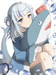 1girl :t absurdres air_bubble bangs blue_eyes blue_hair blue_hoodie blurry blurry_foreground blush bubble closed_mouth depth_of_field eyebrows_visible_through_hair feet_out_of_frame fish_tail gawr_gura hair_ornament highres hololive hololive_english hood hood_down hoodie knees_up long_sleeves looking_at_viewer multicolored_hair pla0658 pout shark_tail silver_hair sitting sleeves_past_wrists solo streaked_hair stuffed_animal stuffed_shark stuffed_toy tail two_side_up virtual_youtuber white_background wide_sleeves