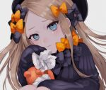 1girl abigail_williams_(fate) bangs black_bow black_dress black_headwear blonde_hair blue_eyes bow breasts closed_mouth dress fate/grand_order fate_(series) forehead hair_bow hat highres long_hair long_sleeves multiple_bows orange_bow parted_bangs polka_dot polka_dot_bow ribbed_dress sleeves_past_fingers sleeves_past_wrists small_breasts stuffed_animal stuffed_toy sumi_(gfgf_045) tears teddy_bear