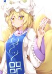 1girl animal_ears blonde_hair closed_mouth commentary_request eyebrows_visible_through_hair fox_ears fox_tail hair_between_eyes hat multiple_tails rururiaru short_hair simple_background smile solo tabard tail touhou white_background yakumo_ran yellow_eyes