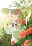 1girl absurdres alternate_costume bangs blonde_hair blue_dress camera chinese_commentary ciyana dress eyebrows_behind_hair flower forest hair_flower hair_ornament hat highres holding holding_camera holding_clothes holding_hat indie_virtual_youtuber lens_flare long_hair looking_at_viewer nature open_mouth red_flower smile solo summer sun_hat sunlight virtual_youtuber white_headwear yellow_eyes zhongchun_ci