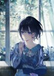 1girl achiki bangs black_hair blue_dress blue_eyes blue_flower book bookmark bush buttons closed_mouth collarbone commentary dress eyebrows_visible_through_hair floral_print flower hair_between_eyes holding holding_book indoors long_sleeves looking_away medium_hair open_book original see-through_sleeves smile solo symbol_commentary upper_body window