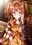 1girl apron bangs bell blush book chair checkered checkered_kimono closed_mouth clothes_writing cowboy_shot glasses hair_bell hair_between_eyes hair_ornament hand_up highres holding holding_eyewear indoors japanese_clothes kimono library long_sleeves looking_at_viewer medium_hair motoori_kosuzu red_eyes ruu_(tksymkw) sitting solo table touhou twintails wooden_chair