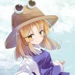 1girl bangs blonde_hair blue_sky blush brown_eyes brown_headwear closed_mouth clouds commentary_request day eyebrows_visible_through_hair hat highres looking_at_viewer moriya_suwako outdoors purple_skirt purple_vest ryogo shirt skirt skirt_set sky smile solo touhou turtleneck vest white_shirt