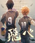 2boys absurdres back ball black_hair feathers from_behind haikyuu!! hand_on_shoulder hieroglyphics highres hinata_shouyou holding holding_ball kageyama_tobio makapirro male_focus multiple_boys orange_hair short_hair sportswear volleyball_uniform