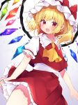 1girl :d ascot bangs blonde_hair bow cowboy_shot crystal eringikinono eyebrows_visible_through_hair fang flandre_scarlet frilled_shirt frilled_shirt_collar frilled_skirt frilled_sleeves frills hat hat_bow highres looking_at_viewer mob_cap one_side_up open_mouth puffy_short_sleeves puffy_sleeves red_bow red_eyes red_skirt red_vest shirt short_hair short_sleeves skin_fang skirt skirt_set smile solo standing touhou vest white_headwear white_shirt wind wind_lift wings yellow_neckwear