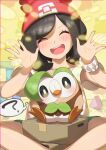 1girl ? absurdres bangs beanie blush brown_hair closed_eyes commentary_request cosplay dartrix dartrix_(cosplay) eyebrows_visible_through_hair eyelashes gen_7_pokemon green_shorts hands_up hat head_tilt highres medium_hair open_mouth pokemon pokemon_(creature) pokemon_(game) pokemon_sm red_headwear rowlet selene_(pokemon) shiny shiny_skin shirt short_sleeves shorts sitting smile spread_legs starter_pokemon t-shirt taisa_(lovemokunae) thought_bubble tongue upper_teeth yellow_shirt z-ring |d