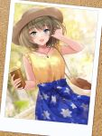 1girl :d arm_up bag bangs beige_headwear blue_eyes blue_shirt blurry blurry_background breasts cup disposable_cup dust_particles eyebrows_visible_through_hair floral_print frilled_shirt frills green_eyes green_hair hand_in_hair handbag hat heterochromia highres holding holding_cup idolmaster idolmaster_cinderella_girls kirifrog looking_at_viewer medium_breasts medium_hair mole mole_under_eye open_mouth picture_(object) shirt sleeveless sleeveless_shirt smile solo sun_hat takagaki_kaede vine_print watch yellow_shirt