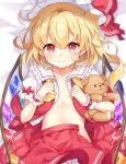 1girl bangs blonde_hair blush closed_mouth collarbone cowboy_shot crystal eyebrows_visible_through_hair flandre_scarlet flat_chest hat highres holding holding_stuffed_toy looking_at_viewer mob_cap one_side_up open_clothes open_shirt paragasu_(parags112) petticoat red_eyes red_skirt red_vest short_hair skirt smile solo stuffed_animal stuffed_toy teddy_bear touhou vest wings wrist_cuffs