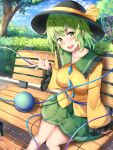 1girl :d bench black_headwear blouse breasts bush clouds cloudy_sky collarbone commentary_request day eyeball feet_out_of_frame frills green_eyes green_hair green_skirt hand_up hat hat_ribbon head_tilt heart heart_of_string highres knees_together_feet_apart komeiji_koishi large_breasts long_sleeves looking_at_viewer nagomian open_mouth outdoors ribbon short_hair sitting skirt sky smile solo third_eye touhou tree waving yellow_blouse